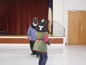 Two fencers continue their dance