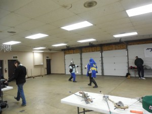 Two fencers do battle