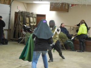Sword and cape vs two swords