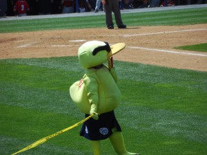 Reading Phillies mascot holds finish line tape